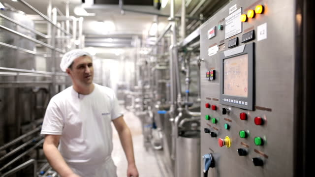 young man working at a food factory - dairy product stock videos & royalty-free footage