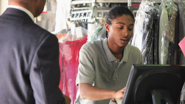 ms pan young man working at dry cleaners, helping customer / richmond, virginia, usa.  - receipt stock videos & royalty-free footage