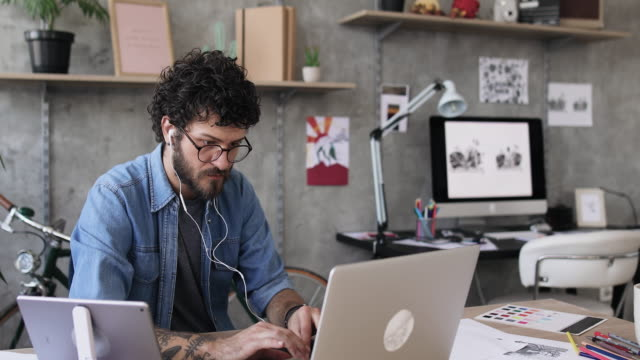 young man working from home - small office stock videos & royalty-free footage
