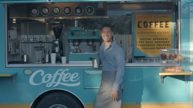 young man working in a food truck - selling stock videos & royalty-free footage