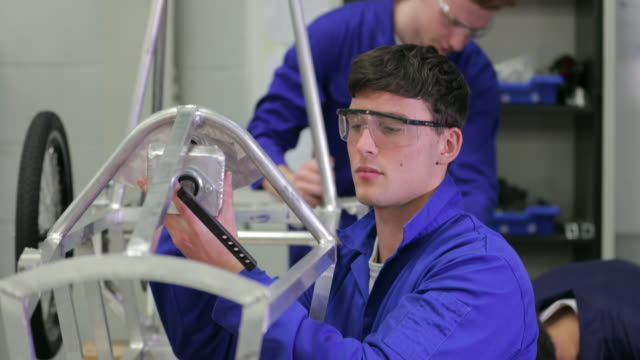 young man working in the engineering workshop - training course stock videos & royalty-free footage
