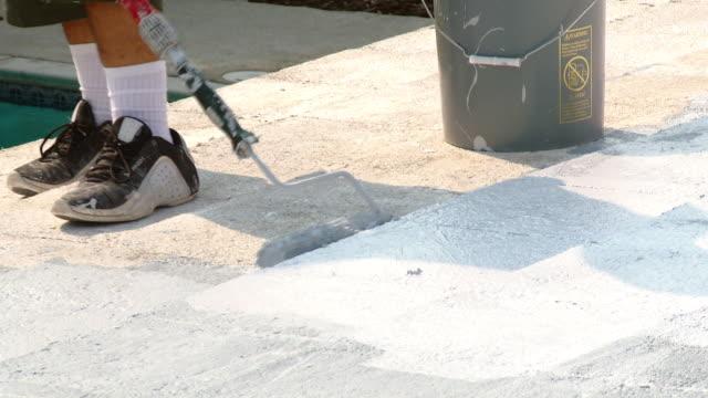 MS ZO Young man working on concrete shingled patio roof / Rancho Mirage, California, USA.