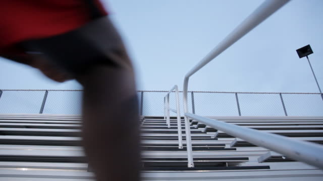 ms young man working out and exercising on  set of bleachers near  field at dusk / minneapolis, minnesota, united states - steps and staircases stock videos & royalty-free footage