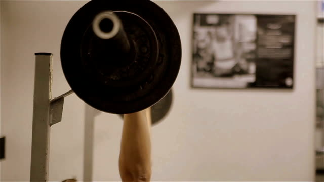 Young man  working out with dumbbells in gym,b roll