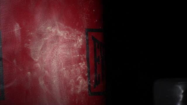 cu young man's chalk covered punching red punching bag / orem, utah, usa - punching stock videos & royalty-free footage