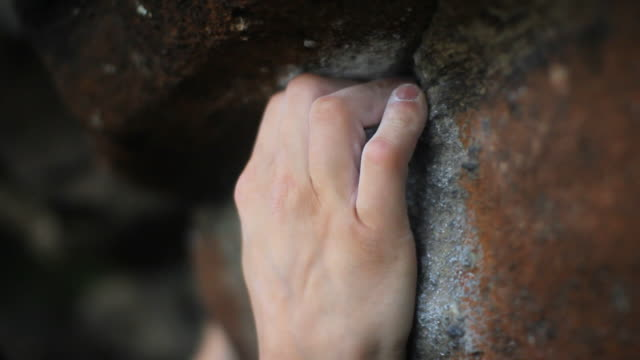 a young manâ??s hands as he is bouldering.  - filmed in hebden bridge, yorkshire, england, europe - gripping stock videos and b-roll footage