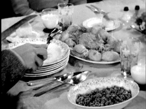 1945 b/w cu young man's hands hesitantly plating meat course / united states /  audio - マナー点の映像素材/bロール