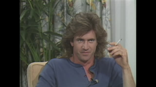 young mel gibson on smoking - smoking activity stock videos & royalty-free footage