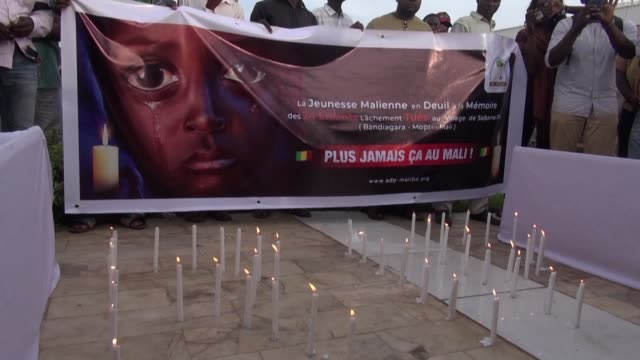 young members of various political parties and from the civil society gather to commemorate the victims of a massacre in mali's powder keg central... - keg stock videos and b-roll footage