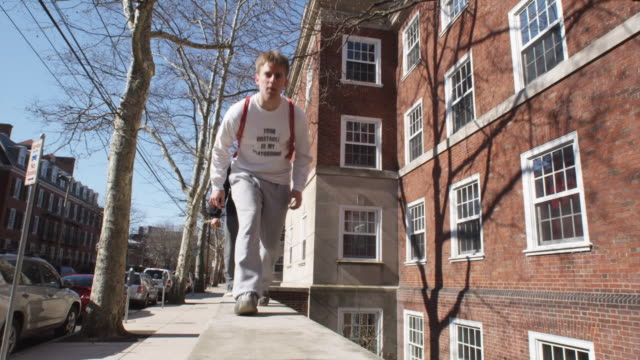 ws la young men and boys (16-17) walking and crawling on wall, new haven, connecticut, usa - new haven stock-videos und b-roll-filmmaterial