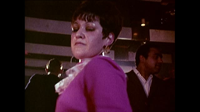 young men and women dancing in a nightclub in 1960's - bbc archive stock-videos und b-roll-filmmaterial