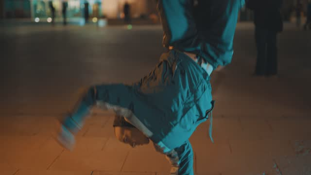 young men breakdancing in an outdoor urban location at night on april 17 in bristol, united kingdom. - cool attitude stock videos & royalty-free footage