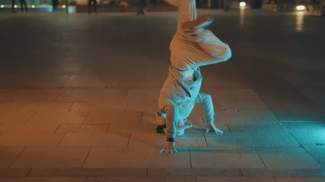 young men breakdancing in an outdoor urban location at night on april 17 in bristol, united kingdom. - vitality stock videos & royalty-free footage