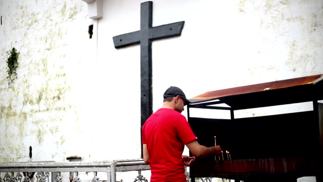 young men burning candlelight in panjim church, goa - christianity stock videos and b-roll footage