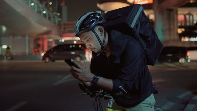 young men delivering goods are using smartphones at night - government minister stock videos & royalty-free footage