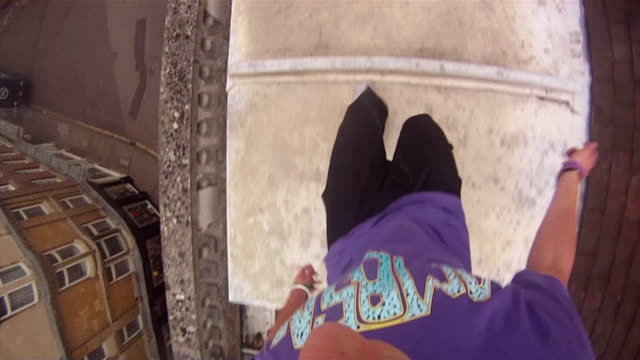 POV of young men doing a parkour freerunning jumping and flipping stunt. - Model Released - HD