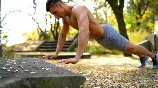 young men doing push up outdoors - bodyweight training stock videos & royalty-free footage