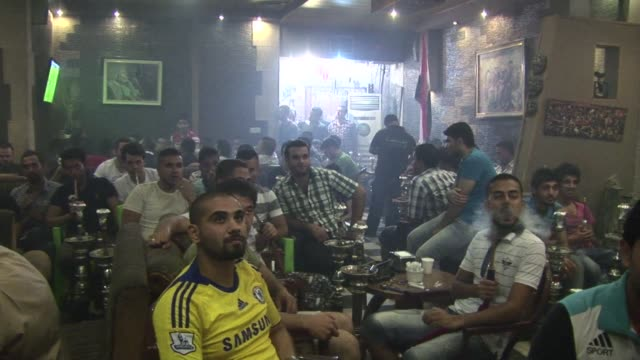 young men flooded the jungle night cafe in baghdad on wednesday night to watch their team play against uruguay in the u 20 world cup semi finals in... - sportweltmeisterschaft stock-videos und b-roll-filmmaterial
