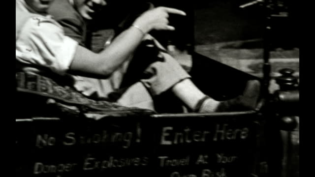 young men from the 1943 class of danville high school goof around in a ford model t that they have customized. - cartello di divieto di fumo video stock e b–roll