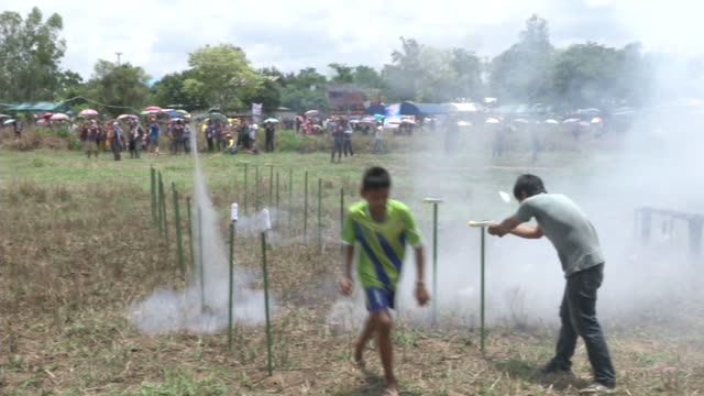 young men ignite fireworks and a rocket fails to launch during the ban bung fai rocket festival in yasothon, thailand. - failure to launch stock videos & royalty-free footage
