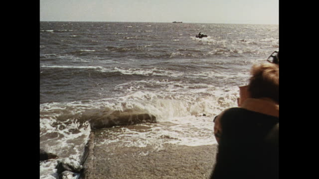 stockvideo's en b-roll-footage met montage young men launching boat and training in sea-rescue in wales / united kingdom - men