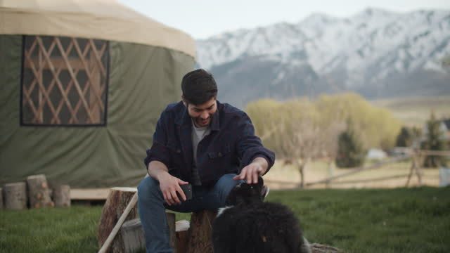 young men living in a yurt in the mountains - snowcapped mountain stock videos & royalty-free footage