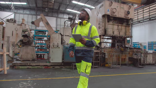 young men of african american ethnicity age 30 yearold he is engineer use tablet computer walking while examming control and solution of machinery in factory industrial.indurty 4.0,blue collar workers concept. - only men stock videos & royalty-free footage
