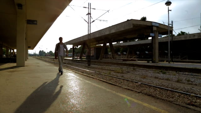 Young men on the railroad station,travel concept