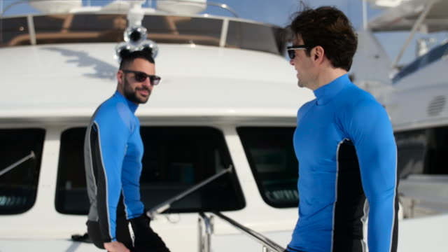 young men on yacht. - matching outfits stock videos & royalty-free footage