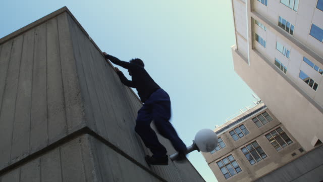 ws la young men performing parkour stunts, new haven, connecticut, usa - climbing stock videos & royalty-free footage