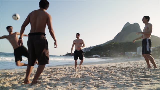 MS, LA Young men play football on Ipanema Beach / Rio de Janeiro, Brazil