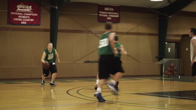 ws pan young men playing basketball in gymnasium / buena vista, virginia, usa - scoring stock videos and b-roll footage