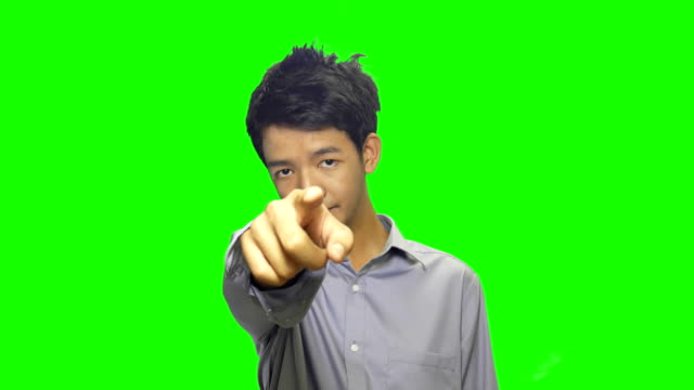 young men pointing toward camera green screen background - pointing stock videos & royalty-free footage