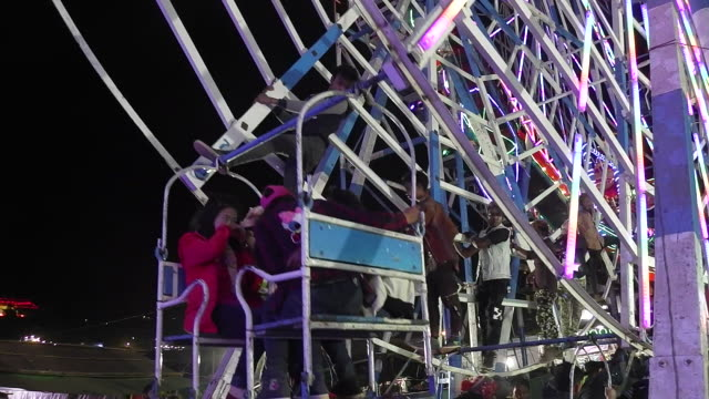 Young Men Power Ferris Wheel at the annual Taunggyi Fire Balloon festival in Taunggyi Myanmar Hundreds of teams from Taunggyi and surrounding...