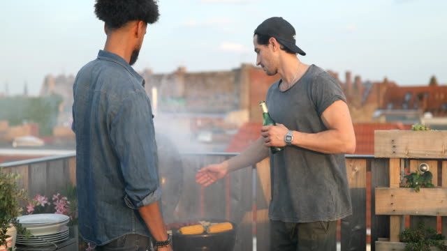 young men preparing food on barbecue grill - grilled stock videos and b-roll footage