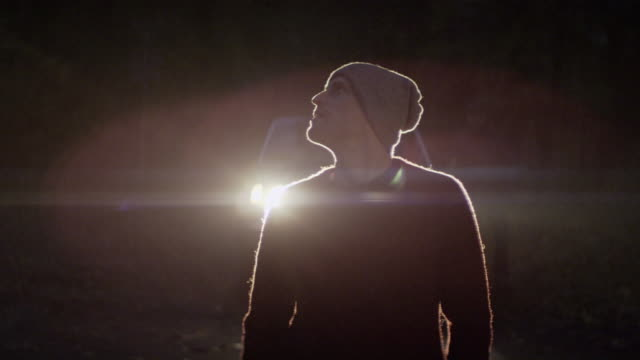 young men standing in front of a car at night - red cap stock videos & royalty-free footage