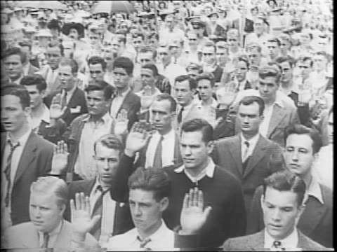 young men take the oath of enlistment in the navy in washington, dc / in baltimore soldiers parade with flags / new army recruits march in the parade... - military recruit stock-videos und b-roll-filmmaterial