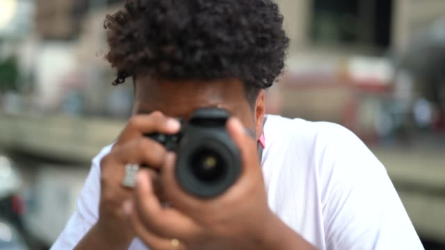 young men taking a picture - photography themes stock videos & royalty-free footage