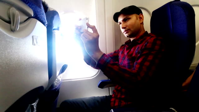 young men taking selfie in commercial airplane - one man only stock videos & royalty-free footage