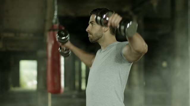 Young Men Training With Dumbbells