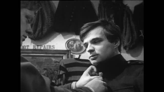 young men try on military coats in carnaby street; 1967 - offbeat stock videos & royalty-free footage