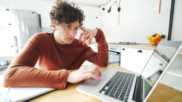 Young men using a laptop.