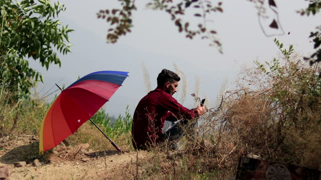 young men using mobile phone in mountains - one teenage boy only stock videos & royalty-free footage
