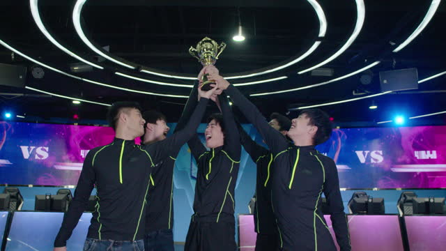 young men winning esports competition,4k - tilt up stock videos & royalty-free footage