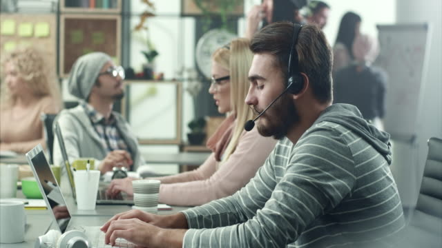 young men working in call center - switchboard operator stock videos & royalty-free footage