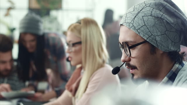 young men working in call center - headset stock videos and b-roll footage
