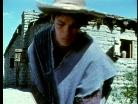 stockvideo's en b-roll-footage met 1963 reenactment ms young mexican farmworker using a rake / 1820s texas / audio  - manifest destiny