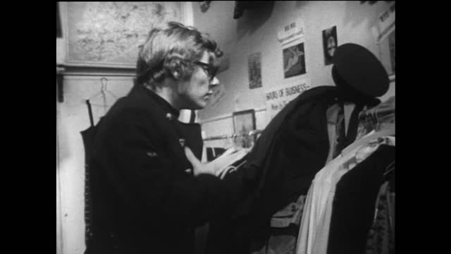 young michael caine lookalike tries on military coat in carnaby street; 1967 - offbeat stock videos & royalty-free footage