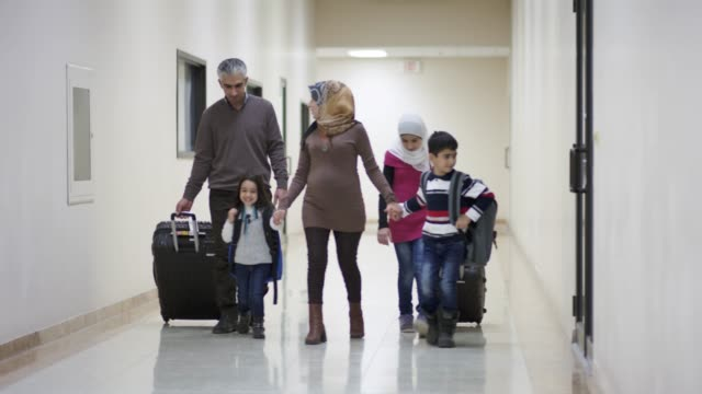 young middle eastern family immigrating to america - immigrant stock videos & royalty-free footage