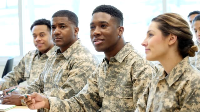 young military soldier asks a question during class at military academy - military recruit stock videos & royalty-free footage